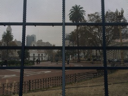 'Plaza de Mayo', seen through one of the police fences in front of 'Casa Rosada'