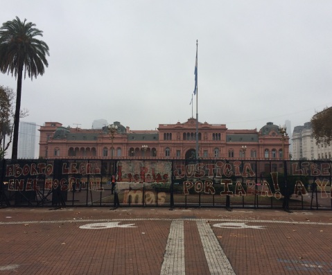 The presidential palace 'Casa Rosada' is currently protected by police fences covered with demands