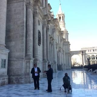 Verne sneaks up behind the security guards to snap a closer picture of Arequipa's Cathedral