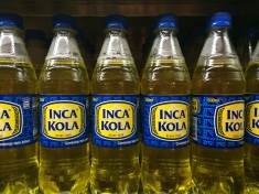 A last bottle of Inca Kola at the airport (Jules hates it, Verne loves it)