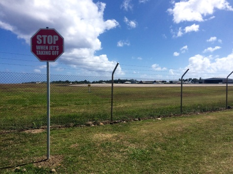 This stop sign is routinely ignored by thrill seekers looking for some jet blast