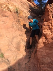 Jules tries out some rock scrambling in the Red Rock