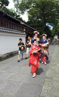 Three beautiful Geishas coming down the street, nearby the Kodaiji temple