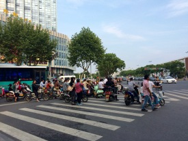 When crossing a road in China you need first to pay attention to the cars still coming, then to all the motorcycles and bicycles that will deliberately be in your way and finally try to make the full length of the road in the few remaining seconds that you still have left before the sign turns again!