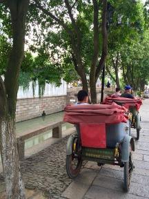 Rickshaws are still part of the landscape in Suzhou