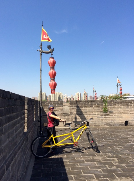Jules shows off our tandem bicycle in one corner of the city wall