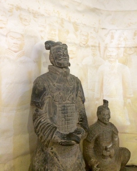 The closer you can get to a terracotta warrior is at the souvenir shop, but these are most likely copies, not the real thing