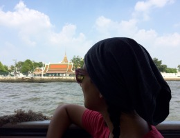 Jules enjoys a boat ride across Bangkok