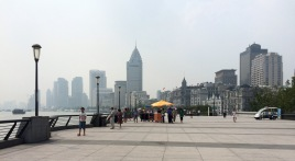 Waitan (also known as the Bund) next to the river Huangpu's bend...