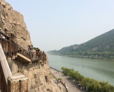 The Longmen Grottoes were carved in limestone across both shores of river Yi