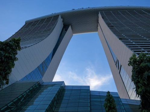 This is the Marine Bay Sands, a three tower hotel with an infinity pool on that banana shaped terrace (photo credits: Susan Selgren)