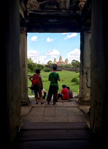 Our first view of Angkor Wat's central structure, after crossing the outer moot and wall