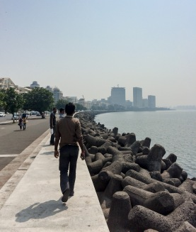 Indian tourists walking down Marine Drive