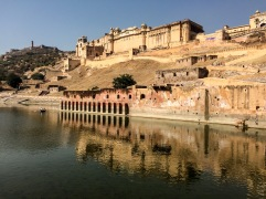 The Amer Fort sits on top of a steep hill, next to the Maota Lake