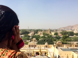A fellow visitor admires the Jantar Mantar from one of Hawa Mahal's balconies