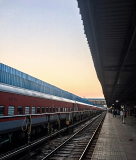 Waiting for the train to Agra at sunrise