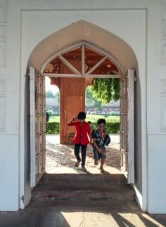 Two kids playing around in the fort's gardens