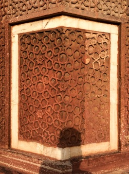 Most of the fort is covered in intricate red sandstone carvings with white marble inlays