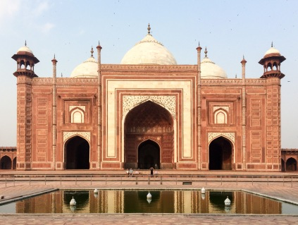 The Taj Mahal is surrounded by a few buildings, including this mosque