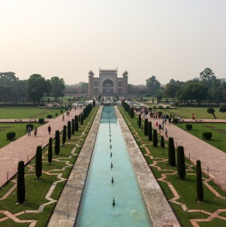 A view of the British style gardens Lord Curzon built, as seen from the Taj Mahal. The structure in the background is the Darwaza-i raze, the main entrance to the complex