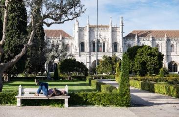 A man relaxes near the Jerónimos Monastery (Lisbon, Portugal)
