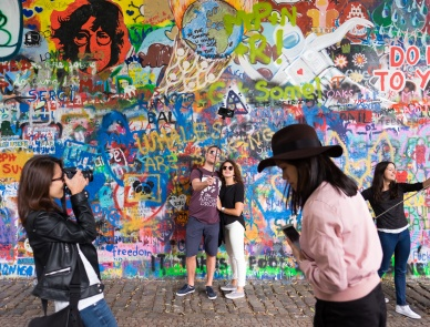 Tourists at the Lennon Wall, Prague (16mm, 1/125s, f2.2, ISO 200)