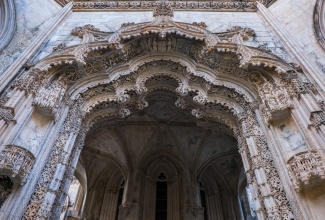 Entrance to the 'Imperfect Chapels', in an intricate Manueline style (Batalha, Portugal)