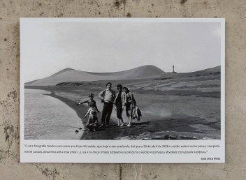 "The caption reads: ""This is a picture taken on a beach that no longer exists, replaced by deep sea. I remember it was April 20th of 1958, the volcano was completely quiet, so we came to this beach (...) my brothers and I were playing when the volcano started erupting again, with great violence"""