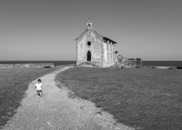 Gabriel walks towards Hermitage of Saint Catherine, Mundaka, Spain (PPL3-Altered)